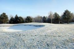 Schnee auf einem Golfplatz Stockfotos