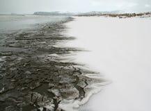 Schnee auf Strand Stockfoto