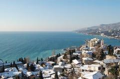 Schnee deckte Stadt ab Stockfoto