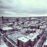 Schnee deckte Stadt ab Stockbild