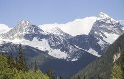 Schnee drei bedeckte Berge Stockfotografie