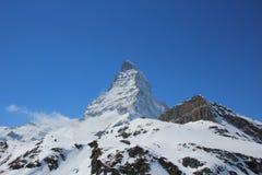 Schnee mit einer Kappe bedecktes Matterhorn Stockfotos