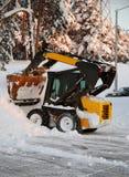 Schnee-Reinigungsmittel Stockfotografie