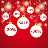 Schnee-roter Hintergrund-weißer Flitter-Verkauf Stockfoto