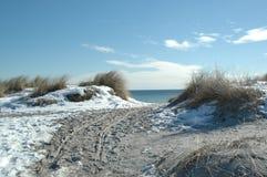 Schnee am Strand Stockfotografie