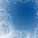 Schnee Tracery auf einem blauen Hintergrund mit Glanz Lizenzfreie Stockfotos