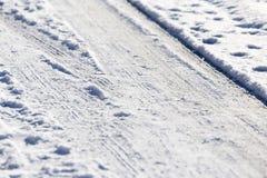 Schnee und Eis auf der Straße Lizenzfreies Stockbild