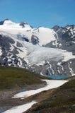 Schnee und See am Sommer Lizenzfreies Stockbild