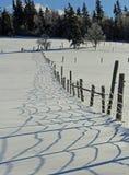 Schnee-Zaun Shadows Landscape Stockbild