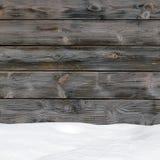 Schneeantrieb auf hölzernen Brettern Stockfotos