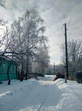 Schneebedeckte ländliche Straße lizenzfreies stockbild