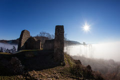 Schneeburg ancient ruin above fog Stock Image