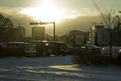 Schneefallen u. -sonnenuntergang Lizenzfreie Stockfotos