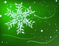 Schneeflocke auf grünem Hintergrund Stockfotografie
