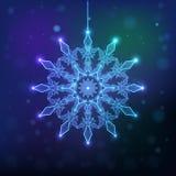 Schneeflocke funkelt auf einem dunklen Hintergrund, Lizenzfreie Stockfotografie