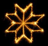 Schneeflocke gemacht durch Wunderkerze auf einem Schwarzen Lizenzfreie Stockbilder