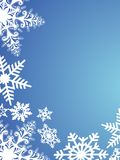 Schneeflocken auf blauem Hintergrund Stockbilder