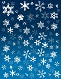 Schneeflocken auf blauem Hintergrund lizenzfreies stockbild