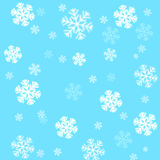 Schneeflocken auf einem Himmelblauhintergrund Stockfotografie