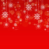 Schneeflocken auf Rot Stockbild