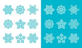 Schneeflocken, blaue Dekorationsikonen des Winters eingestellt Lizenzfreie Stockfotos