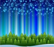 Schneeflocken, die auf einem Pfad der blauen Leuchte absteigen Stockfotografie