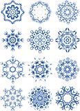 Schneeflocken eingestellt auf Weiß Lizenzfreies Stockfoto