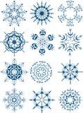 Schneeflocken eingestellt auf Weiß Stockfotografie