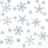 Schneeflocken von verschiedenen Arten auf einem Hintergrund des Blaus, Muster Lizenzfreies Stockfoto