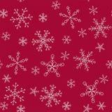 Schneeflocken von verschiedenen Arten auf einem Hintergrund des Rotes, Muster Stockfotos