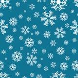 Schneeflockenmuster auf Blau Stockfotos