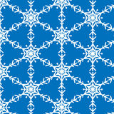 Schneeflockenvektormuster auf Blau Stockfoto