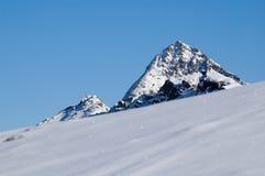 Schneegebirgsspitze Stockbilder