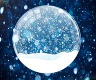 Schneekugel auf blauem Hintergrund mit bokeh Stockfoto