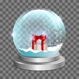 Schneekugel mit Geschenkbox Stockfotografie