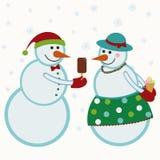 Schneemänner geben Geschenke Lizenzfreie Stockfotografie