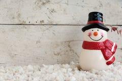 Schneemann auf dem Schnee Stockfotografie