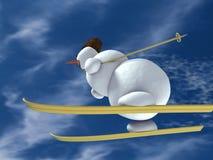 Schneemann auf den Skis stockfotografie