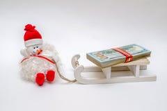 Schneemann auf einem Schlitten Stockfotos