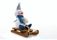 Schneemann auf einem Schlitten Stockfoto