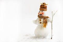Schneemann auf einem weißen Hintergrund mit Besen Stockbilder