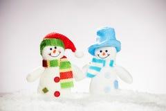 Schneemann auf Schnee Stockbilder