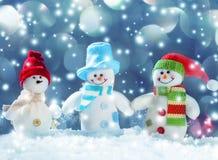 Schneemann auf Schnee Stockbild