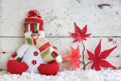 Schneemann, der auf Schnee in Japan sitzt Lizenzfreie Stockbilder