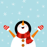 Schneemann, der Schnee genießt Stockfoto