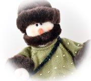Schneemann in der Strickjacke und im Hut Stockfotos