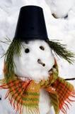 Schneemann in einem Hut und in einem Schal Stockfoto