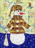 Schneemann in einem Mantel Lizenzfreie Stockbilder