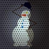 Schneemann in einem schwarzen Hut Lizenzfreies Stockfoto