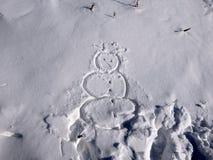 Schneemann gezeichnet in Schnee stockbilder